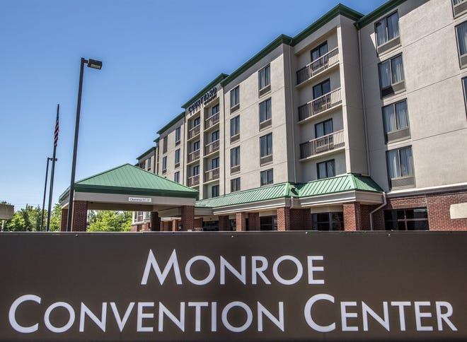 The Monroe Convention Center sign is seen with the neighboring Courtyard by Marriott hotel in the background along South College Avenue. Expansion of the convention center could be paired with the private sector building and additional connecting hotel.