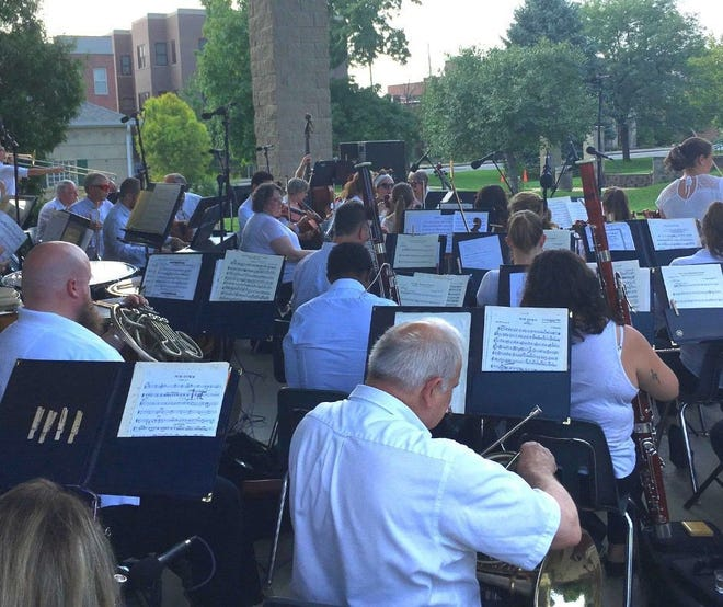 The Bloomington Symphony Orchestra will perform Aug. 29 at Bloomington's Switchyard Park. Members perform here at another city park.