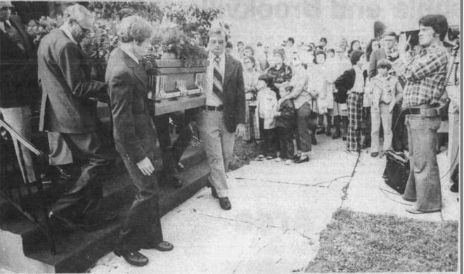 """The casket is carried out after Ann Harmeier's funeral 42 years ago. Her then-10-year-old cousin, Scott Burnham, is on the right side wearing plaid pants. This pictures tops the Facebook page """"Where is Ann."""" (Courtesy photo)"""
