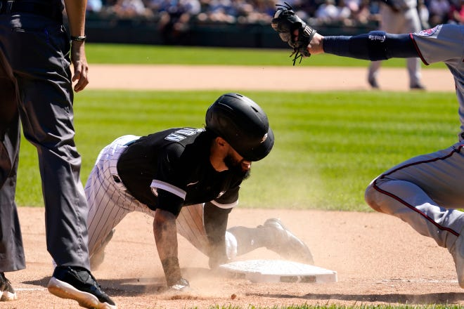 Chicago White Sox's Billy Hamilton steals third against Minnesota Twins third baseman Josh Donaldson during the sixth inning of a baseball game in Chicago, Thursday, July 1, 2021. (AP Photo/Nam Y. Huh)