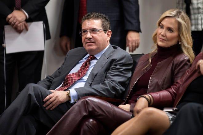 Washington Redskins owner Dan Snyder and his wife Tanya Snyder listen to head coach Ron Rivera during a press conference at the team's NFL football training center in Ashburn, Va., On January 2, 2020. Dan Snyder's wife Tanya was named co-CEO of the Washington football team on June 29, 2021, giving him greater influence at the club which was in the midst of an independent investigation about misconduct at work that the NFL oversees.