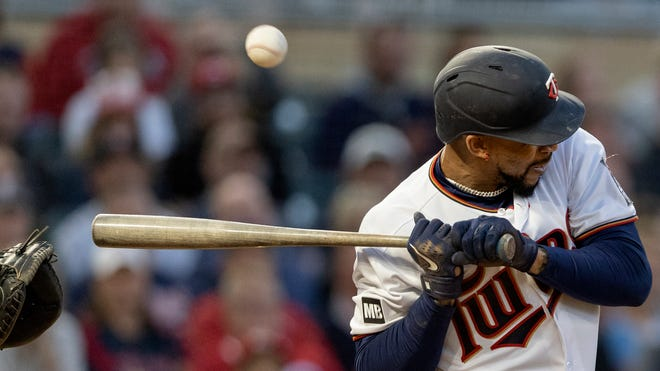 Minnesota Twins' Byron Buxton is hit by a pitch in the fourth inning of a baseball game against the Cincinnati Reds, Monday, June 21, 2021, in Minneapolis. (Carlos Gonzalez/Star Tribune via AP)