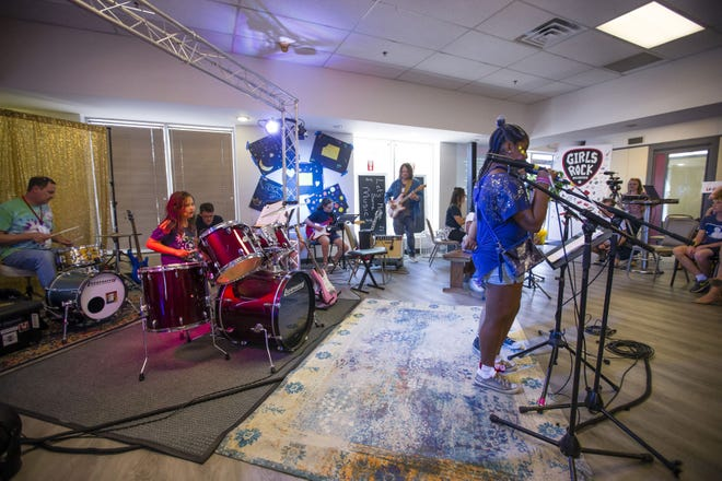Girls perform during the Girls Rock Camp performance July 13 at The Music Village.