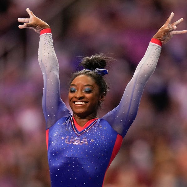 Simone Biles smiling while competing
