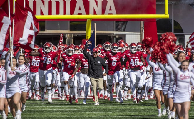 Head coach Tom Allen leads the Hoosiers onto the field at Memorial Stadium before a game against Rutgers last season. (Rich Janzaruk / Herald-Times)