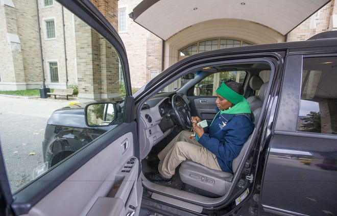Taneka Jones is making use of a ride-sharing program to take on more shifts parking cars at Notre Dame.