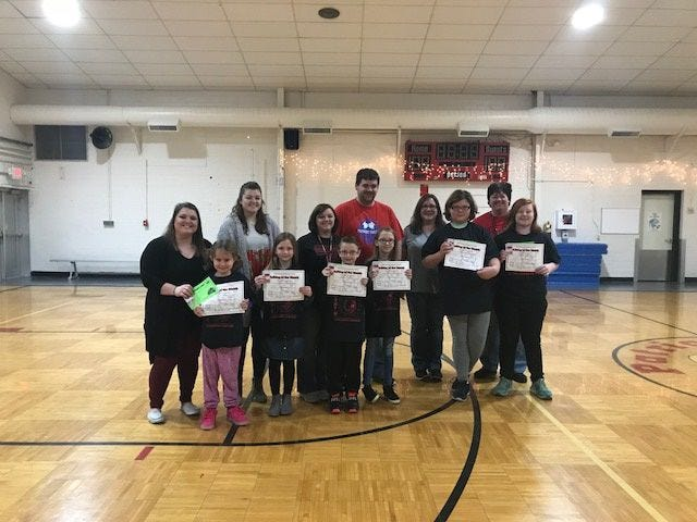 Patricksburg Elementary recently announced the Bulldogs of the Month for both November and December. November recipients pictured are, front row, from left: Lyla Beam, Emma Rubottom, William Mullis, Estelle Milligan, Freedom Dorman and Ciara Roberts. Back row: Mrs. Fidler, Ms. Truax, Mrs. Ames, Mr. Leichter, Mrs. Young and Ms. Nairn.