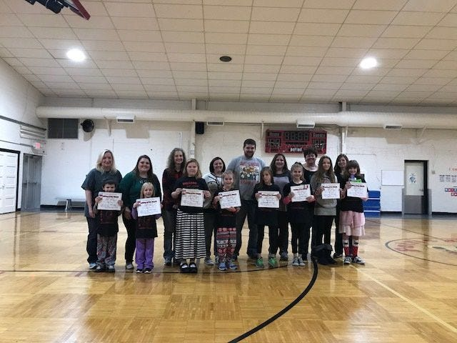 December PES Bulldog of the Month recipients pictured are, front row, from left: Ethan Brumley, Aspyn Pugh, Rozlynn Buffington, Rya White, Gracey Galbraith, Daliylah Lohman, Madisyn Moats and Amelia Cox. Back Row: Ms. Taylor, Mrs. Fidler, Mrs. Gee, Mrs. Ames, Mr. Leichter, Mrs. Young, Ms. Nairn, and Ms. Vladoiu.