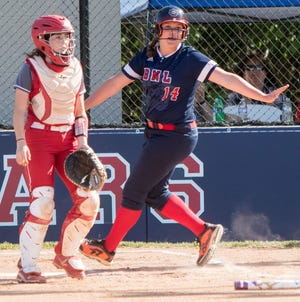 BEDFORD — Former BNL softball star Sarah Stone signifies that she's safe at home. (Garet Cobb / Times-Mail)