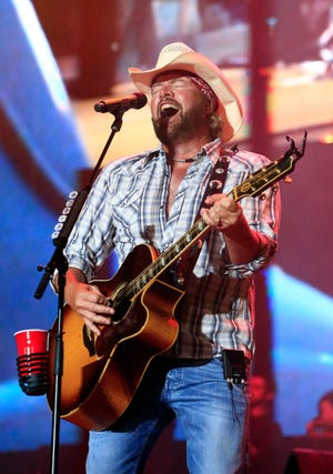 In this July 6, 2013 file photo, Toby Keith will perform at the Oklahoma Twister Relief Concert at the Gay Road Family Oklahoma Memorial Stadium in Norman, Oklahoma. The tornado relief concert hosted by Keith will raise $ 2 million and will be donated to tornado relief. A fund run by the United Way in Central Oklahoma. (Photo courtesy of Alonzo Adams, File / Invision / AP, File)