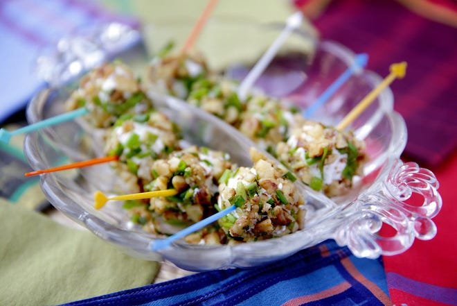 Grapes are rolled in goat cheese, walnuts and chives in a simple appetizer.
