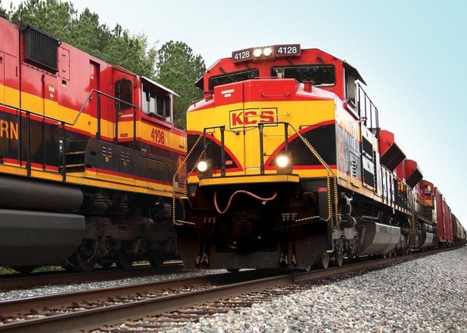 Two Kansas City Southern trains passing each other.