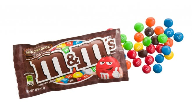 The first M&M debuted in 1941 in Newark, New Jersey. The candy-coated chocolate was designed specifically for the military in World War II. The M&M's hard shell makes it relatively heat resistant, meaning it doesn't readily melt in your hand. The American candy is still made in New Jersey by Mars Chocolate North America. M&Ms are also made in Cleveland, Tennessee and Topeka, Kansas. ALSO READ: 17 Popular Products You Can't Find Outside of America