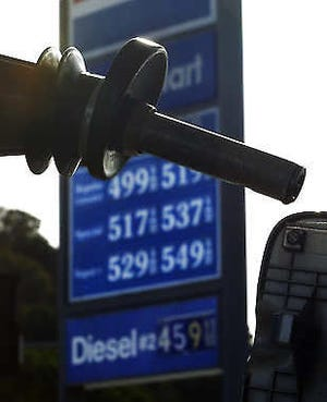 A motorist gasses up Saturday at a station in the Calabasas area of Los Angeles. The price of gasoline hit an all-time average high in California over the weekend, fueled by a reduced supply and a volatile market. Mark J. Terrill | Associated Press
