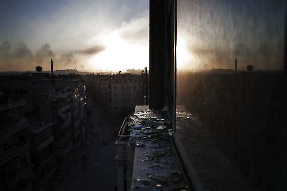 In this Saturday, Oct. 13, 2012 photo, smoke rises from a damaged building in Aleppo, Syria. (AP Photo/ Manu Brabo)