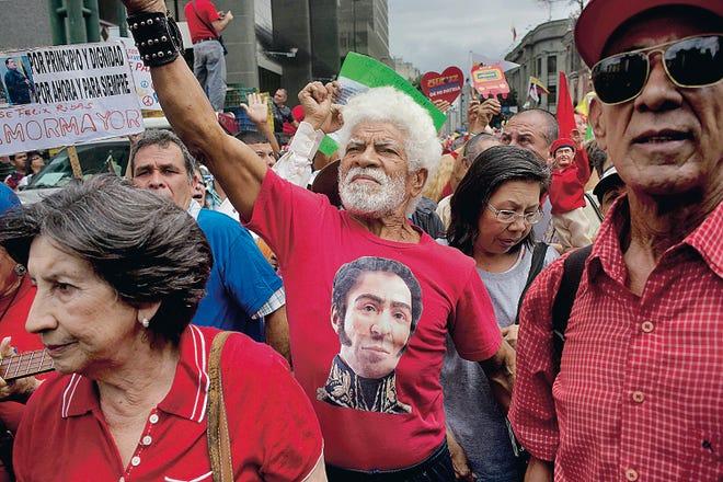 A man wearing a T-shirt of Venezuela's independence hero Simon Bolivar chants pro-government slogans Sunday during a march by elderly people in Caracas, Venezuela. Rodrigo Abd   Associated Press