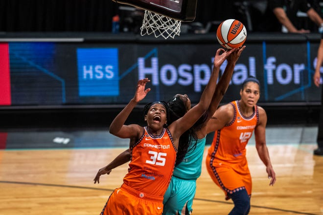Connecticut Sun Jonquel Jones (35) forward attempts to rebound the ball after a free throw attempt by New York Liberty Reshanda Gray (1) during the first half of a WNBA basketball game Sunday, July 11, 2021, in New York. (AP Photo/Brittainy Newman)