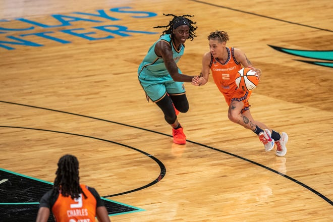 Connecticut Sun guard Natisha Hiedeman (2) dribbles across the court past New York Liberty guard Jazmine Jones during the second half of a WNBA basketball game Sunday, July 11, 2021, in New York. (AP Photo/Brittainy Newman)