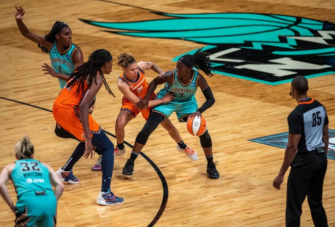 Connecticut Sun guard Natisha Hiedeman (2) tries to steal the ball from New York Liberty Jazmine Jones (4) during the first half of an WNBA basketball game Sunday, July 11, 2021, in New York. (AP Photo/Brittainy Newman)