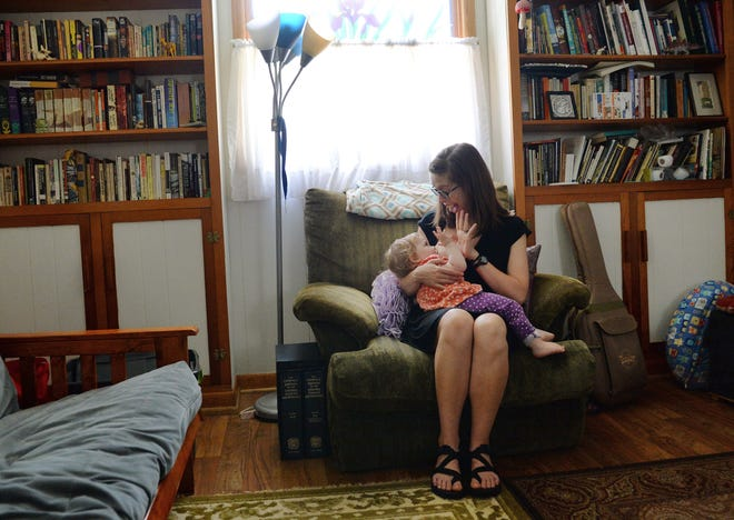 Kirstin Milks breast-feeds her 15-month-old daughter Nemora Cloud at their home in Bloomignton.Chris Howell | Herald-Times