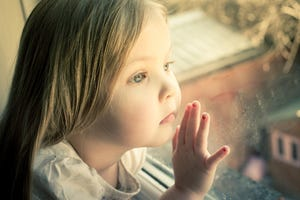 A child looks out the window.