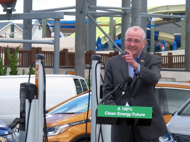 New Jersey Gov. Phil Murphy speaks at a news conference in a parking lot in Seaside Heights, N.J., on Friday, where four electric vehicle charging stations were recently installed.