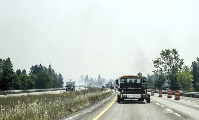A section of I-90 is down to one lane due to heavy smoke near Cataldo, Idaho, as wildfires rage in the area Wednesday.