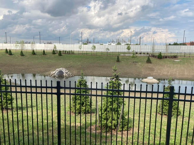 A retention pond sits in a stormwater park near the new Stellantis Detroit Assembly Complex on the east side of Detroit. The park is a greenspace reconfigured to filter rainwater runoff before it flows into sewer systems.