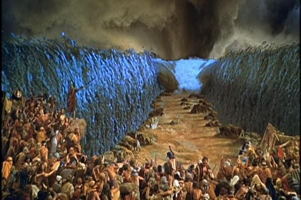 """The Red Sea is parted by God through Moses to facilitate the Israelites' escape from Egypt in Cecil B. DeMille's 1956 classic """"The Ten Commandments."""" Paramount Pictures (courtesy)"""