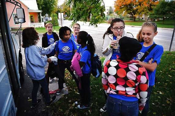 Members of the Boys and Girls Club's Rockin' All-Star Ninja Choir gather outside the bus before loading up to rehearse for their luncheon performance Oct. 5 at the Midwest Leadership Conference in Indianapolis.