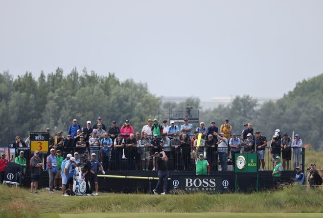 Spain's Jon Rahm plays his tee shot on the 3rd during a practice round for the British Open Golf Championship at Royal St George's golf course Sandwich, England, Tuesday, July 13, 2021. The Open starts Thursday, July, 15. (AP Photo/Ian Walton)