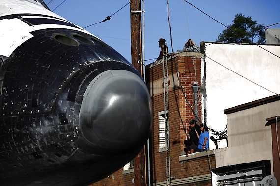 Spectators take photos of the space shuttle Endeavour, as it moves down Martin Luther King Boulevard on Sunday, Oct. 14, 2012 in Los Angeles. (AP Photo/Los Angeles Times, Michael Robinson Chavez, Pool)