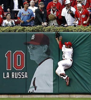 St. Louis center fielder Jon Jay makes a leaping catch at the wall during the sixth inning of Game 2 of the NLDS Monday in St. Louis. The Cardinals won 12-4. Chris Lee | Associated Press