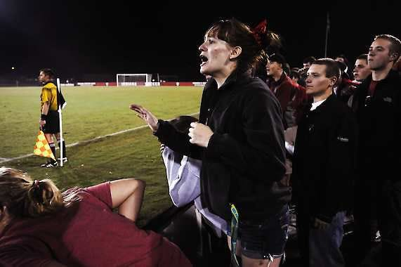 Abbygail Parker, center, an Indiana University freshman from Avon, stands in the middle of the Hoosier Army area, cheering for the men's soccer team as they play Notre Dame at Bill Armstrong Stadium on Sept. 26.