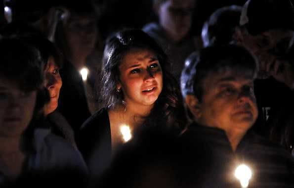 """A young woman cries during the candlelight vigil on Saturday night, Oct. 13, 2012, at the Bay State Commons, for Westboro's Elizabeth """"Lizzi"""" Marriott, a University of New Hampshire student, who disappeared earlier in the week. Marriott is believed to be dead, and a man has been charged with second-degree murder. (AP Photo/Steve Lanava, Worcester Telegram & Gazette)"""