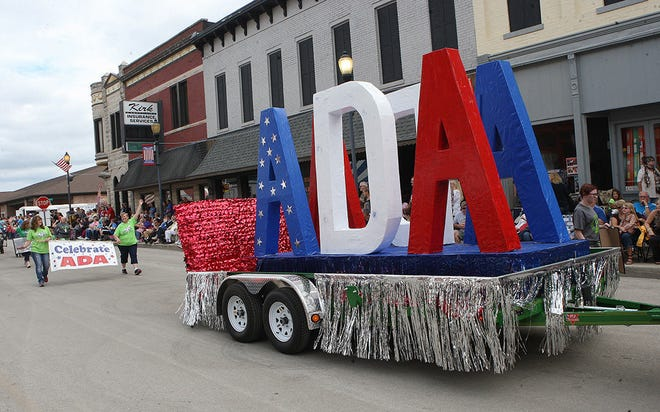 An Americans with Disabilities Act float at a parade in Mitchell, Ind.