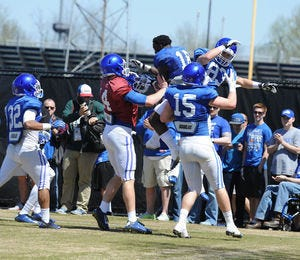 Stoops not ready to name starting quarterback but pleased with spring practice by team