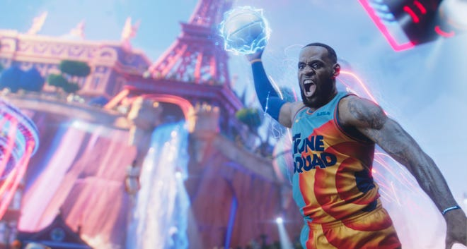 """LeBron James dunks on the Goon Squad in a scene from """"Space Jam: A New Legacy."""""""