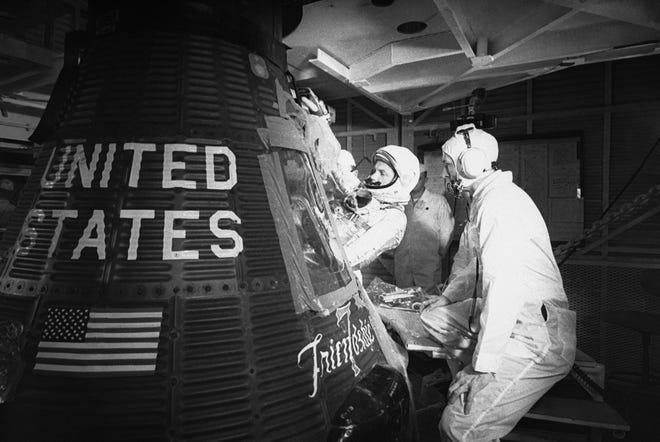 Astronaut John Glenn climbs into the Friendship 7 Mercury capsule at Cape Canaveral, Fla., on Jan. 2, 1962.