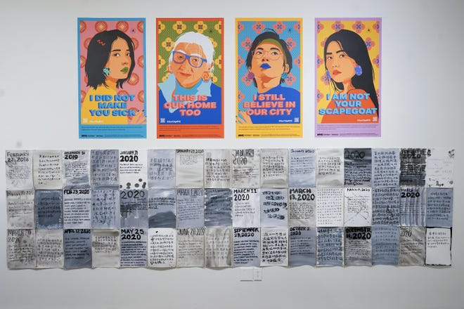 """Posters created by the City of New York to combat Asian hate are on display during the press preview of """"Responses: Asian American Voices Resisting the Tides of Racism"""" at the Museum of Chinese in America on Wednesday in New York."""