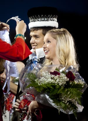 Matthew Hatcher   Herald-Times Matthew Hatcher   Herald-TimesEdgewood's queen and kingLexi Ingalls, the daughter of John and Dawn Ingalls, is crowned Edgewood High School's homecoming queen at the Edgewood-Sullivan football game Friday night in Ellettsville. Standing behind Lexi is Tyler Hornick, the son of Jim and Alita Hornick, who was crowned homecoming king. Edgewood won the game, 14-6.