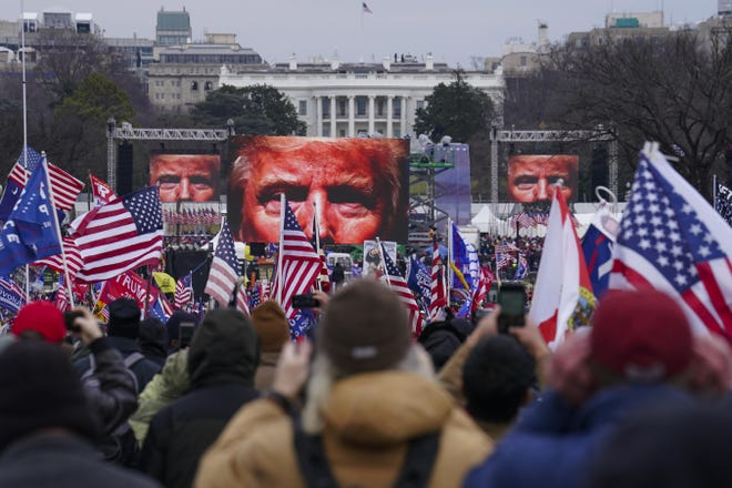 Supporters of then-President Donald Trump participate in a rally Jan. 6, just before a violent mob breached the U.S. Capitol and disrupted the Electoral College process.