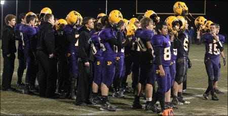 The Paoli football team sings the school s fight song for the last time in the 2014 season following Friday s sectional loss to Milan. (Photo by Aaron Brewington)