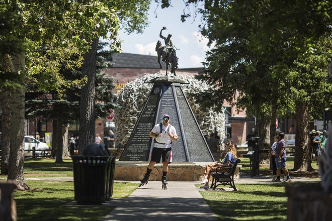 Dusty Campbell is shown in front of the veterans monument on the Town Square in Jackson, Wyo., before he began his 285-mile rollerblade trek to Salt Lake City. Campbell's 47-hour trek was a way to raise money for the Wounded Warrior Project.