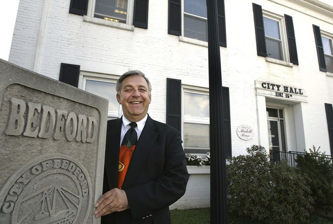 John Williams poses outside Bedford City Hall in October 2003.