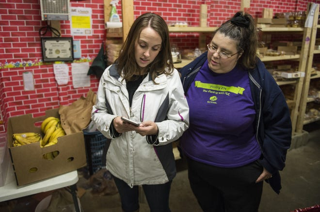Pantry 279 founder and operator Cindy Chavez speaks with Marsha Lovejoy, left, in December 2016. The pantry serves thousands of people each month and nearly ran out of food last week.