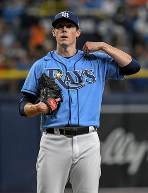 Tampa Bay Rays starter Ryan Yarbrough adjusts his jersey between pitches during the first inning of a baseball game against the Baltimore Orioles, Monday, July 19, 2021, in St. Petersburg, Fla.(AP Photo/Steve Nesius)