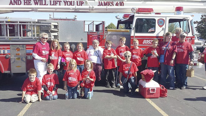 Children, volunteers and staff of Weekday Religious Education participated in the Fall Foliage Festival parade last Sunday. Submitted photo.