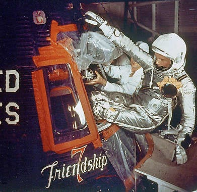 In this Feb. 20, 1962, photo, astronaut John Glenn climbs into the Friendship 7 space capsule atop an Atlas rocket at Cape Canaveral, Fla., for the flight that made him the first American to orbit Earth.NASA | Associated Press