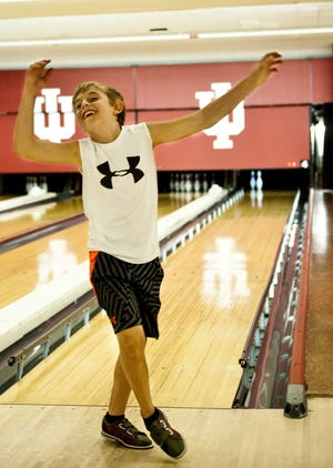 Izaak Green reacts to missing the last two pins while bowling at the IU bowling alley. Izaak along with his mother, Tara, and younger sister, Addison, played a game to celebrate Izaak's 9th birthday on Monday, Sept. 9. Matthew Hatcher | Herald-Times